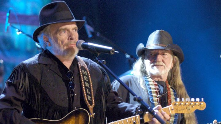 Iconic Rolling Stone photograph of Merle Haggard singing Okie from Muskokie (see embedded video below) with Willie Nelson. At the time Willie Nelson was known for his prodigious marijuana use, e.g.: