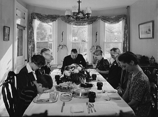 Saying grace before carving the turkey at Thanksgiving dinner in the home of Earle Landis in Neffsville, Pennsylvania, 1941, Marjory Collins, photographer for Farm Security Administration. - Photo by Marjory Collins. Farm Security Administration - Office of War Information Photograph Collection (Library of Congress}. During the 1930s and 1940s some of the greatest photographs were taken for USDA's Farm Security Administration.