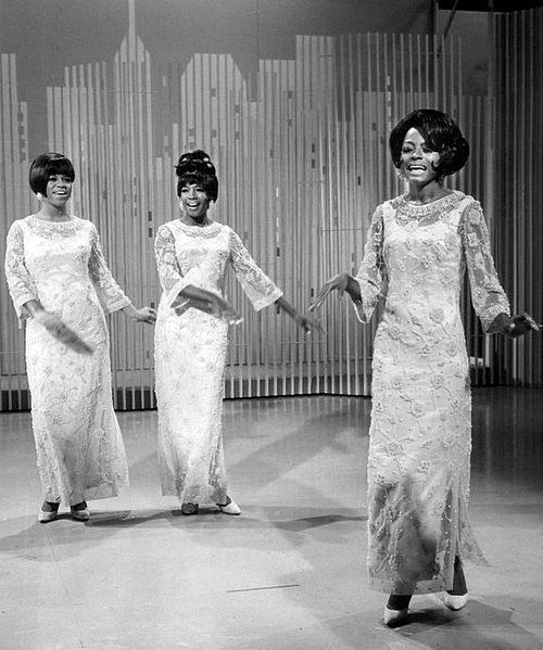 "Photo courtesy of Wikipedia which provides the following caption: ""The Supremes: Diana Ross (right), Mary Wilson (center), Florence Ballard (left) performing 'My World Is Empty Without You' on The Ed Sullivan Show in 1966."""