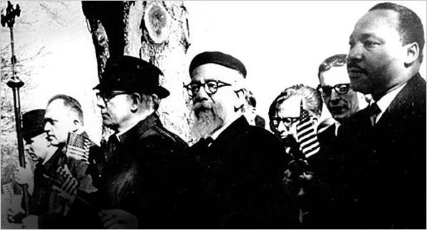 Rabbi Abraham J. Heschel, Professor of Mystecism and Theology at the Jewish Theological Seminary. marches arm-in-arm with Dr. Martin Luther King, Jr. at the Selma-Montgomery March