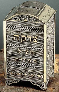 Jewish charity box. The Hebrew צדקה literally means charity. Wikipedia: Tzedakah [tsedaˈka] or Ṣ'daqah [sˤəðaːˈqaː] in Classical Hebrew (Hebrew: צדקה‎; Arabic: صدقة‎), is a Hebrew word literally meaning justice or righteousness but commonly used to signify charity,[1] though it is a different concept than charity because tzedakah is an obligation and charity is typically understood as a spontaneous act of goodwill and a marker of generosity. It is based on the Hebrew word (צדק, Tzedek) meaning righteousness, fairness or justice, and it is related to the Hebrew word Tzadik meaning righteous as an adjective (or righteous individual as a noun in the form of a substantive). In Judaism, tzedakah refers to the religious obligation to do what is right and just, which Judaism emphasises are important parts of living a spiritual life. Maimonides says that, while the second highest form of tzedakah is to give donations anonymously to unknown recipients, the highest form is to give a gift, loan, or partnership that will result in the recipient supporting himself instead of living upon others.