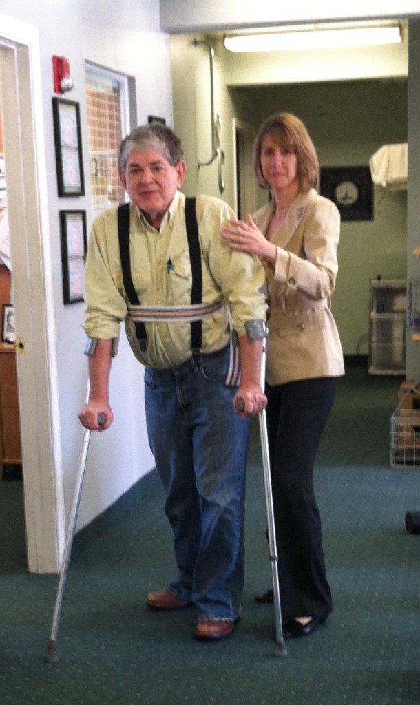 Four years ago Alicia J. Spence at Phoenix Rehab helped me walk using fore-armed crutches to walk. With the proper movement performed religiously each day (and the use of a device that directs electiricity to my ankles (see footnote 12) I might be able to walk someday. First, however, I have to master the pain. Alicia suggested a wonderful exercise that slowly reduces spinal pain when I lie on m stomach.