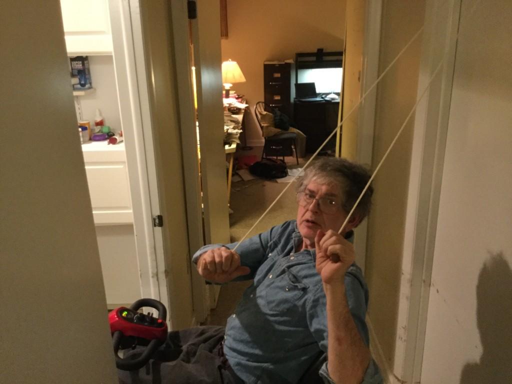 Friend and neighbor John Harris photographs me usin the pulley.