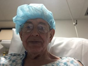 Dressed for surgery. Here is an attempt at a winning smile.