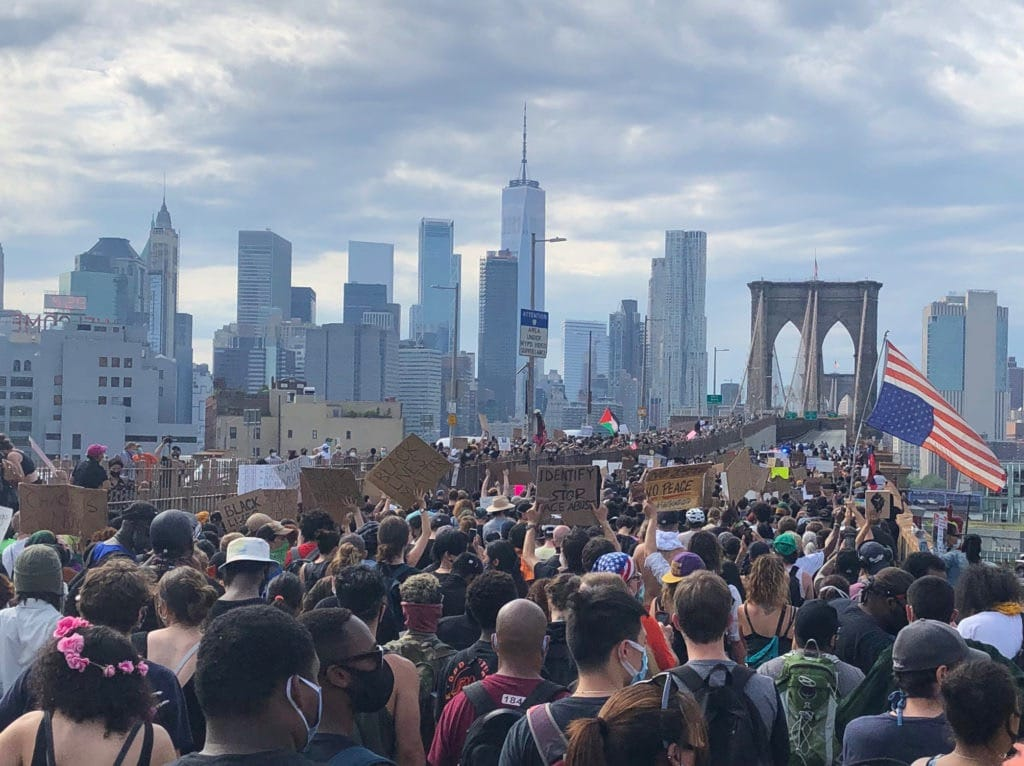 Black Lives Matter march Brooklyn Bridge - USA COVID-19 Deaths Article
